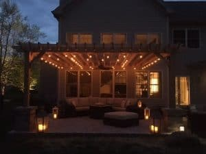 Pergola with lights outside house for holiday decorations