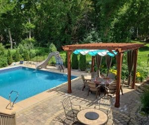 Covered pergola with canopy outside of pool