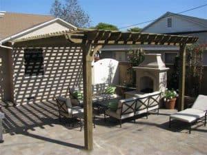 Covered pergola outside over sunny patio