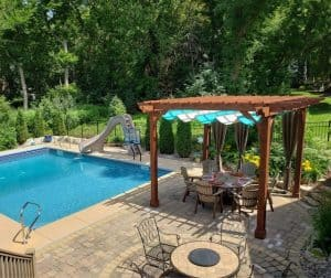 14x14 Sombrero Covered wooden Pergola with canopy near pool