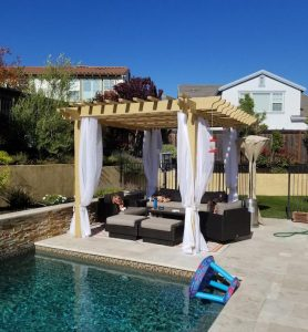 Poolside covered patio with curtains for shade